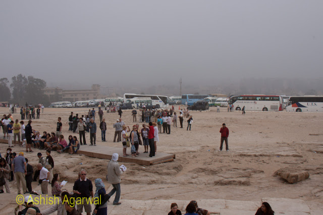 Cairo Pyamids - People standing just next to the Great Pyramid in Giza