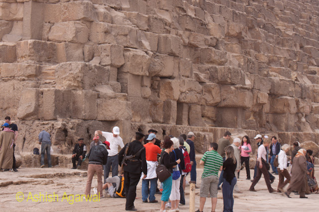 Cairo Pyramids - Group of tourists at the base of the Grand Pyramid