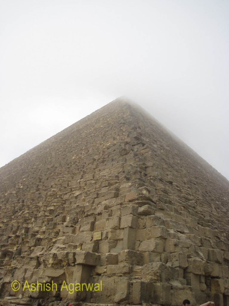 Great Pyramid of Giza - An angular view of the pyrmaid, with fog covering the top of the structure