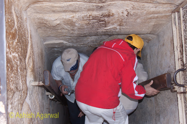 Cairo Pyramids - tourists negotiating their way through the steep ladder when there is a rush