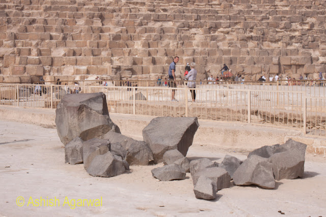 Cairo Pyramids - Some large stones lying on the ground as part of some of the restoration work being carried out at the Great Pyramid