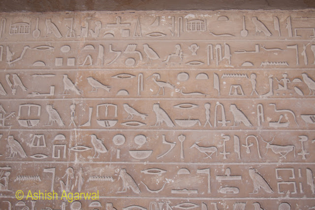 Cairo Pyramids - Calligraphy (symbols made on stone) inside the burial chamber right next to the Great Pyramid