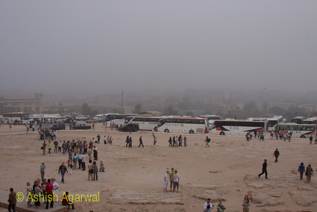 Cairo Pyramid - View of tourists, their buses, and Giza, in the background