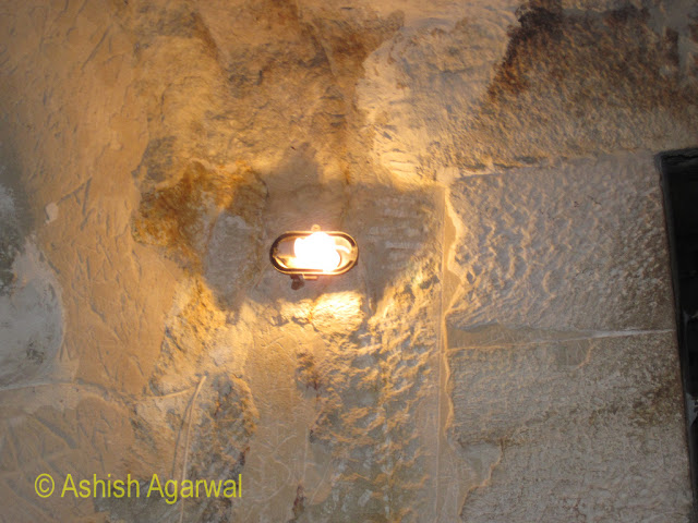 Cairo Pyramids - A light strung up inside the burial chamber next to the Great Pyramid of Cheops