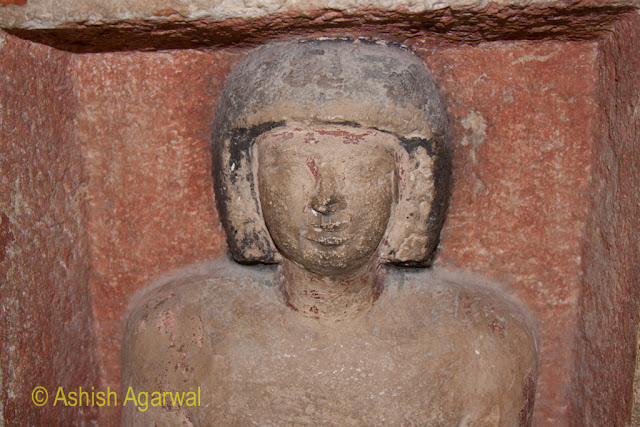 Cairo Pyramid - Photo of the face of a statue in a small structure next to the Great Pyramid