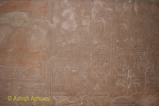 Cairo Pyramids - A full wall containing symbols from long ago next to the Great Pyramid