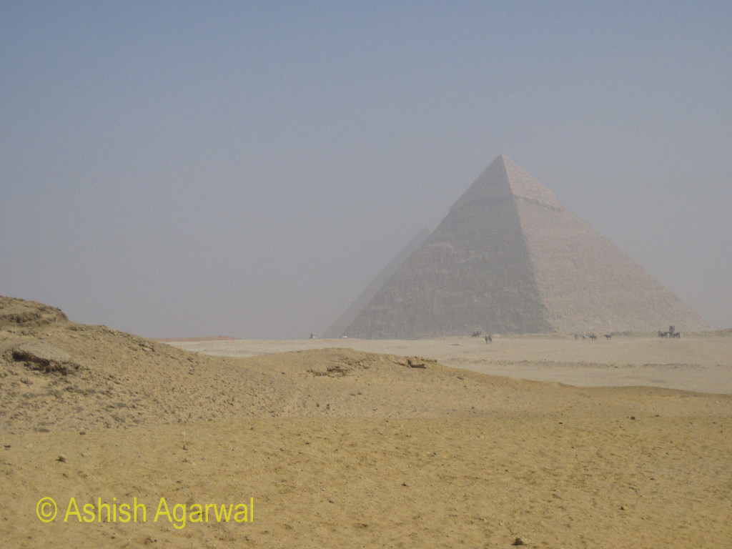View of one Pyramid hiding behind another Pyramid at the Panorama Point in Giza