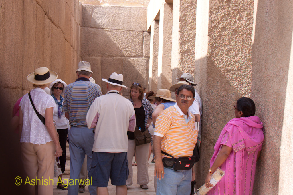 Tourists at a temple right next to The Great Sphinx, in Giza in Egypt