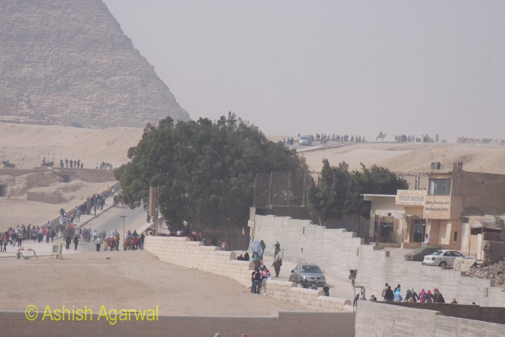 Tourists near the Great Sphinx and the Great Pyramid in Giza