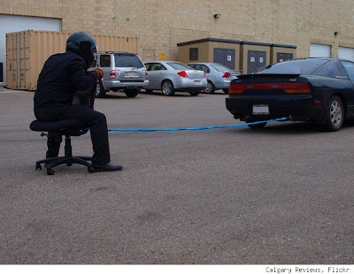 office chair pulled by car