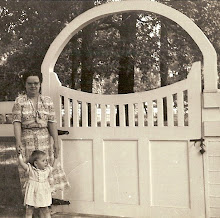 A Young Cassandra &amp; Grandmother Lavenua by her &quot;back-40&quot; gate...