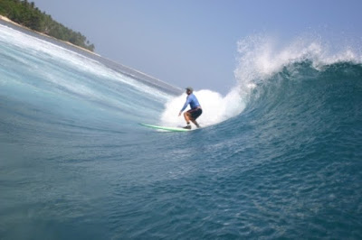 Surfing on the Tanjung Setia Beach, West Lampung, Indonesia