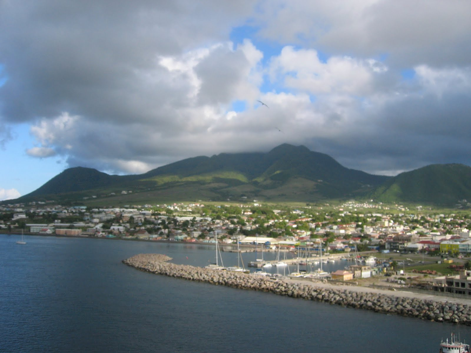 ships dock in the capital of st kitts basseterre sugar cane used to be the main industry on st kitts but most of the plantations have shut down and they