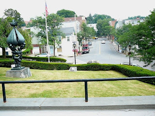 Spring Street in Hastings on Hudson NY from the library with Jacques Lipschitz sculpture in foreground