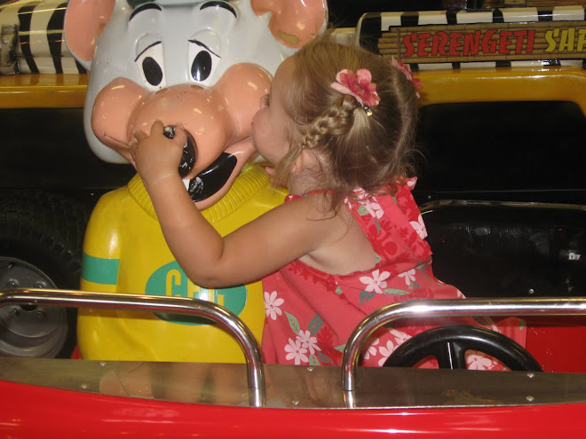 Coco kissing Chucke Cheese