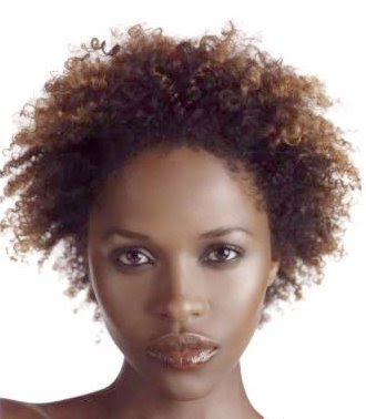 black model Aisha Cain wearing a natural curly black hair style