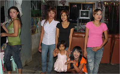 girls in front of the brothel in which they work in Poipet, Cambodia