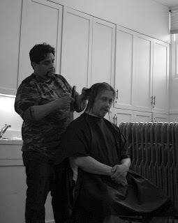 Volunteer cutting guest's hair at Welcome