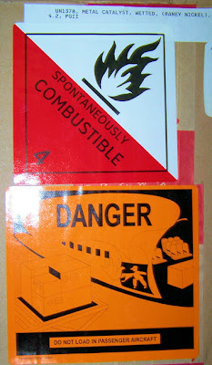 Raney Nickel: Spontaneously Combustible! Danger: Do not load in passenger aircraft!