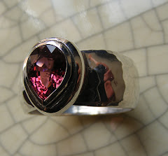 Pools Of Contentment.  Teardrop Shaped Spinel On Hammered Silver Band