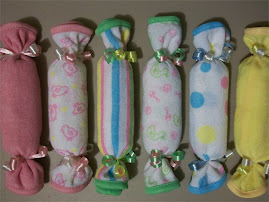 "Washcloth/Diaper ""Tootsie Rolls"""