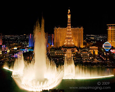View of Paris Paris Hotel Bellagio fountain from Bellagio Hotel Las Vegas at night