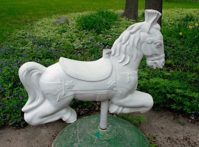 vintage garden playground horses sculpture