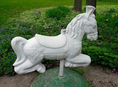 vintage garden playground horses sculpture