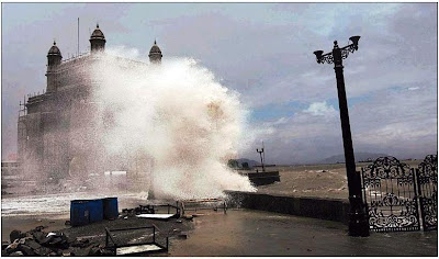 monsoon mumbai wave crashing into Gateway of India monument