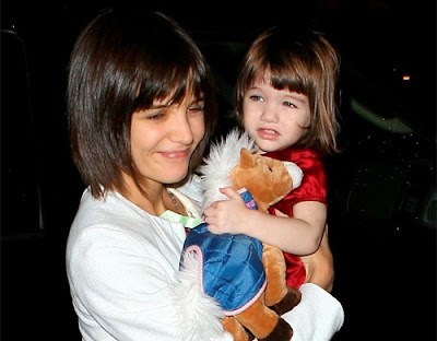 Then Katie did played the look-alike card with their daughter, Suri.