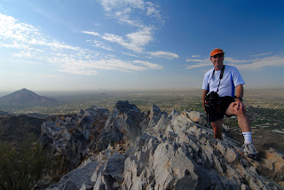 Gene Hanson on the summit of Piestewa Peak, with Black Mountain in the distance