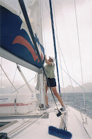 Vicky bringing down the sail in bad weather