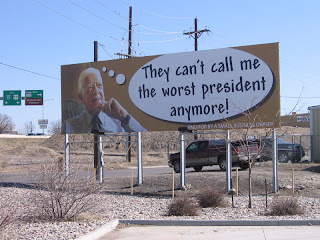 Jimmy Carter billboard in Grand Junction, Colorado with caption: 'They can't call me the worst president anymore!'