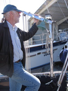 Stan Dabney checking out the small crane on Otter II, a 1979 Valiant 40 centerboard model