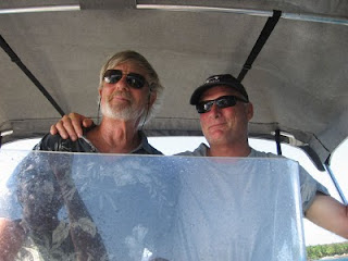Eric at the helm of his skiff with Capt. John