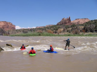 Charlie MacArthur and his students at the 'Little D' rapids in Westwater Canyon