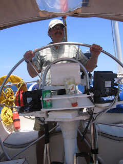 Me at the helm for the sail to Roatan's West End