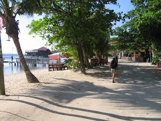 Nan walking the sandy main road in Roatan's West End