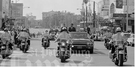 11/18/63, Tampa, FL: agents on limo, motorcycles, close press, military aide