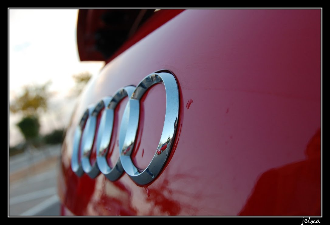 audi logo wallpaper on red car
