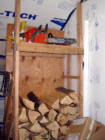 Indoor wood crib and chain saw storage