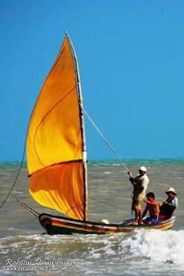 pescadores em barco a vela