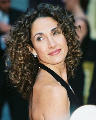 melina kanakaredes curly hair style 2010 Medium Length Curly Hairstyles for