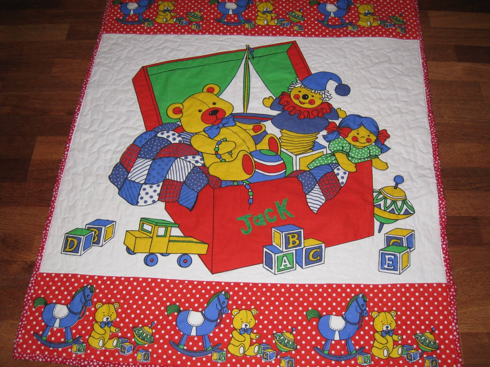 Quilted hugs by sue new baby floor quilt for Floor quilt for babies