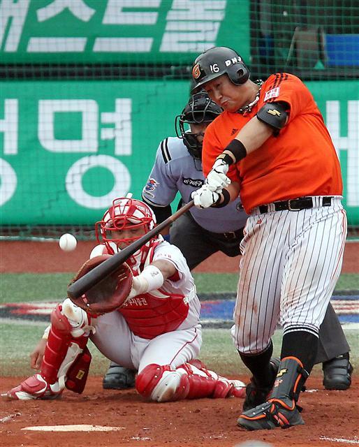 Baseball Player Hitting Home