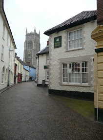 On the left, Cromer through one of its little alleyways, on the right the summit of Beeston Bump