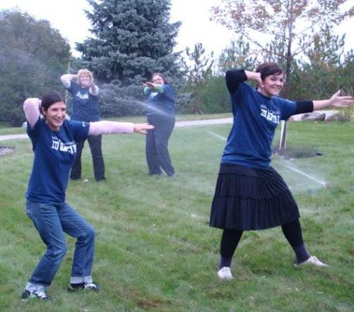 "Doing the ""sprinkler dance"" in front of a working sprinkler!"