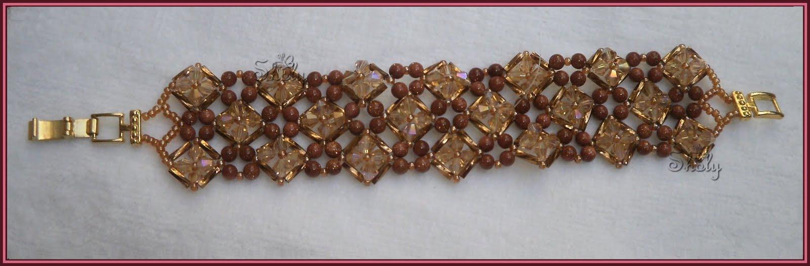 colores reales de la pulsera, hecha con cristales y piedra del sol, su color es lindisimooo me gustooo, ¿¿¿que opinan???