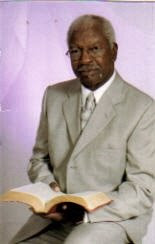 "PASTOR  REV. WILLIAM L. MCCLURKIN USES THE ""GOOD BOOK"""