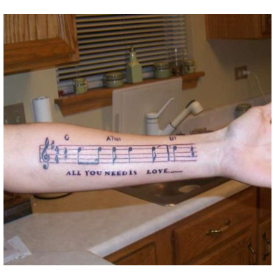tattoos of music. music staff tattoos.
